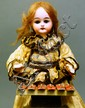 RARE FRENCH BISQUE DOLL MUSIC BOX. Signed S.P.