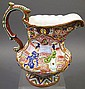 JAPANESE MORIAGE PORCELAIN PITCHER. Raised enamel