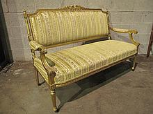 LOUIS XVI STYLE GILT SETEE.  Open arms and back, carved crest and arm ends, flut