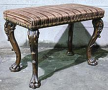 CARVED CHIPPENDALE STYLE BENCH.  Upholstered top and boldly carved legs.  26