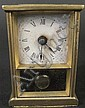AMERICAN MINIATURE BRASS CLOCK. With pendulum.