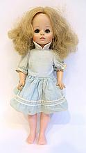 Old Doll With Blinking Eyes In A Blue Dress