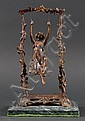 After Auguste Moreau (French, 1834-1917). Patinated bronze and metal figure of a girl on a swing