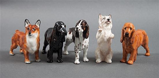Five Royal Doulton china dog figurines