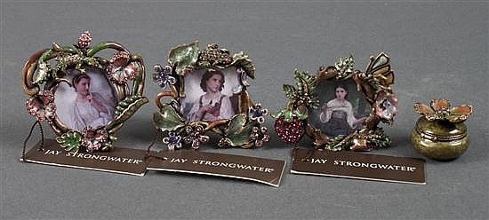 Three Jay Strongwater miniature enameled metal and bejeweled easel-back picture frames, and similar miniature vanity box