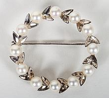 Sterling silver and pearl circular brooch