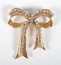 Lady's 14K gold and diamond bow brooch/pendant
