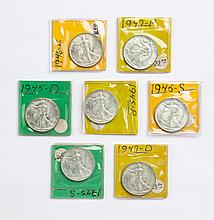 Seven U.S. Walking Liberty half dollars, 1945-'47