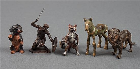 Two Austrian cold painted bronze dogs, patinated bronze lion, lead colt, and a copper ancient warrior