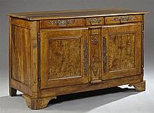 French Louis Philippe Carved Walnut Sideboard, 19th c., the rectangular top over a central frieze drawer flanked by two long frieze...