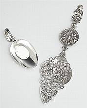 Two .800 Silver Items, early 20th c., consisting of a medicine spoon, and a German pierced pie slice, with figural decoration, Slice...
