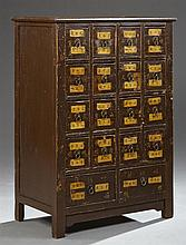 Chinese Ming Style Polychromed Eighteen Drawer Apothecary Cabinet, early 20th c., the dished rectangular top over four rows of four...