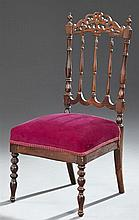 American Victorian Carved Rosewood Child's Chair, late 19th c., the arched pierced foliate crest rail over a spindled back, over a t..