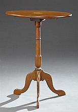 George III Style Inlaid Mahogany Tilt Top Pedestal Table, 20th c., the elliptical inlaid top on a ring turned tapered support on ser...