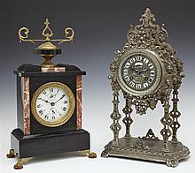 Two French Mantel Clocks, early 20th c., one alarm clock of incised black marble with an urn surmount; the second a spelter portico...