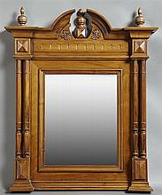 French Henri II Style Carved Walnut Overmantel Mirror, late 19th c., the broken arch crest over a stepped frame flanked by double ri...