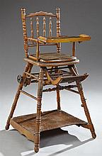 French Victorian Convertible Turned Mahogany Child's High Chair, 19th c., the arched serpentine spindled back with a feeding tray, o..