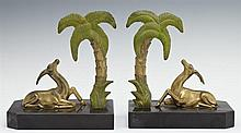 Pair of Art Deco Patinated Spelter Bookends, c. 1940, with gazelles and palm trees, on octagonal black marble bases, H.- 6 in., W.-...