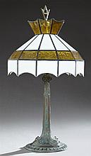 Verdigris Painted Spelter Table Lamp, 20th c., with a tapered reeded support to a relief base, with a later iron frame glass shade,...