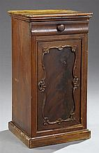 American Late Classical Carved Mahogany Nightstand, 19th c., the curved corner top over a cavetto frieze drawer, above a single cupb...