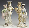Pair of Franco-Bohemian Porcelain Figural Candlesticks, 19th c., the polychromed biscuit porcelain figures astride gilt decorated fl...