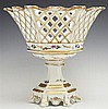 Old Paris Porcelain Reticulated Hexagonal Corbeille, 19th c., with gilt and floral decoration on a stepped hexagonal base on six spl...