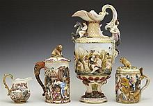 Four Pieces of Capodimonte, 20th c., consisting of a lidded tankard, and a covered tankard, both with relief battle scenes, a cream...