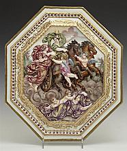 Octagonal Polychromed Capodimonte Porcelain Plaque, 20th c., depicting Diana in a chariot in the clouds, riding above a sleeping wom...