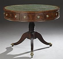 English Regency Style Carved Mahogany Leather Top Rent Table, late 19th c., the green gilt tooled inset leather over a wide skirt wi...