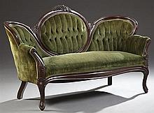 Late Victorian Carved Mahogany Medallion Back Settee, c. 1900, the serpentine grape carved crest rail, over a tufted back with a cen...