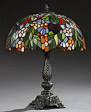 Tiffany Style Bronze Patinated Table Lamp, 20th c., with a domed leaded glass fruit and floral shade, H.- 21 in., Dia.- 17 1/4 in.