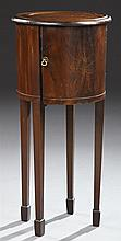 English Carved Mahogany Pot Cupboard, c. 1900, the stepped circular dished top over a cylindrical body with a single door, all on ta...
