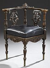 Victorian Rococo Style Carved Mahogany Corner Chair, c. 1880, possibly New York, with a carved foliate curved back rail centered by...