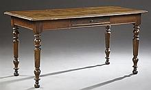French Provincial Louis Philippe Carved Oak and Pine Farm House Table, 19th c., the stepped edge top over a single frieze drawer and...