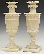 Pair of Carved Alabaster Urn Lamps, early 20th c., with relief leaf decoration, on socle supports to square bases, H.- 13 1/2 in., W...