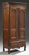 Diminutive French Provincial Louis XV Style Carved Cherry Bonnetiere, 19th c., the stepped crown over double doors with inset panels...