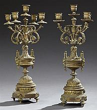 Pair of Louis XV Style Bronze Five Light Candelabra, 19th c., with relief decorated candle cups on floriform bobeches emanating from...