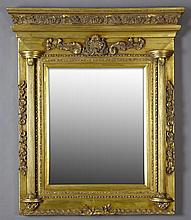 French Overmantel Gilt and Gesso Mirror, 20th c., with a stepped foliate crown over a central relief shell above a wide beveled plat...