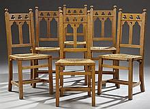 Set of Six French Provincial Gothic Carved Oak Rush Seat Dining Chairs, c. 1900, the trefoil pierced crest rail, over a gothic arche...
