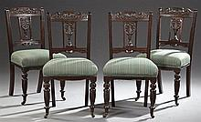 Set of Four English Victorian Carved Mahogany Dining Chairs, c. 1880, the serpentine crest rail with carved acanthus decoration over...