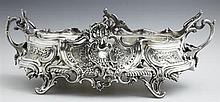Rococo Style Silverplated Brass Table Planter, 20th c., with relief scroll and floral decoration, with a lifting insert, H.- 7 1/8 i...
