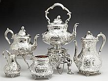 Five Piece English Silverplated Tea and Coffee Set, late 19th c., by Benetfink, consisting of a coffee pot, a teapot, a sugar bowl,...