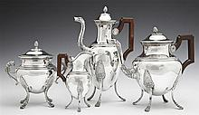 French Four Piece First Standard Silver Tea and Coffee Service, 19th c., of amphora form, consisting of a coffee pot with a swan for...
