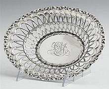 Sterling Reticulated Candy Dish, 20th c., by Whiting, with a repousse rim, retailed by J.E. Caldwell & Co. New Orleans, H.- 1 5/8 in...