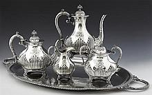 French Five Piece Silverplated Coffee Service, early 20th c., consisting of a coffee pot, teapot, covered sugar and creamer, with ri...