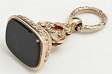 English Gold Plated Bloodstone Watch Fob Seal, c. 1900, uncarved, H.- 1 13/16 in., W.-1 in., D.- 3/4 in.