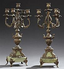 Pair of French Louis XV Style Patinated Spelter and Green Onyx Five Light Candelabras, c. 1900, the five candle cups and bobeches wi...