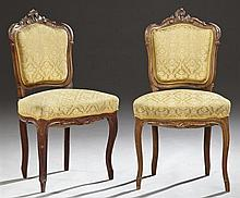 Pair of French Louis XV Style Carved Walnut Parlor Chairs, late 19th c., the scroll carved serpentine crest, over a shield form back...