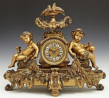 Gilt Spelter Mantel Clock, 19th c., by A.D. Mougin, time and strike, the drum clock with a handled urn surmount with bird finial and...