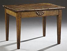 French Provincial Carved Mahogany Farm Table, c. 1830, the three plank top over a wide skirt with applied fan decoration, on tapered...